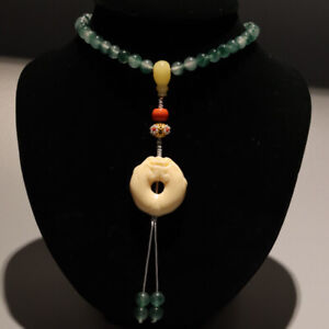 Vintage green stones and beads necklace with enamel circular pendant.