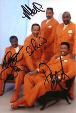 A 6 x 4 inch photo featuring The Temptations, personally signed by 4 of them.