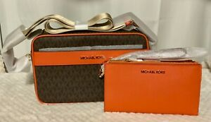 """Authentic Michael Kors """"Kenley"""" tangerine brown mono with matching wallet."""