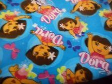 dancing dora the explorer & boots hawaiian  100% cotton  per fat quarter