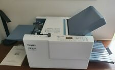 Duplo Df-970 folding machine. Used Very little.  Excellent condition.