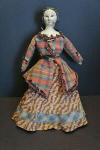 antique carved wood doll as found in old, original clothing, carved head, hair