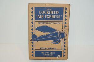 """Ertl """"Lockheed Air Express"""" 1929 Daytona Beach Diecast Coin Bank Airplane"""