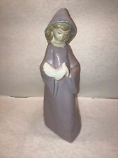 Nao by Lladro - Girl Holding a Dove in a Mauve Dress with Blue Hood