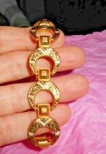 Gold colored bracelet etched circles with clasp 7 inches