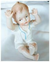 "Vintage Arnart Bisque Porcelain Piano Baby Figurine Sitting Boy 5.5"" Arms in Air"
