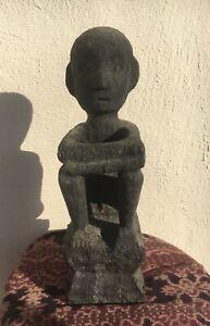 antique or old, big, hand-carved hardwood Ifugao rice god,Philippines