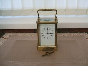ANTIQUE / HEAVY BRASS TWO TRAIN STRIKING CARRIAGE CLOCK
