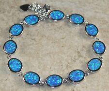 Silver Elegant Blue Fire Opal Oval Bracelet