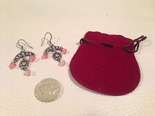 Antique looking chandelier earrings with pink stones in a pouch