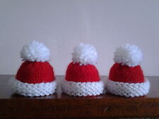 3 CHRISTMAS HAT HAND KNITTED EGG COSIES / BOTTLE TOPPERS. SMALL HATS