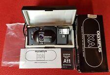 Olympus XA Telemetro + flash A11 con Zuiko 35 mm f 2.8