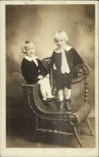Cute Kids TWINS Wicker Chair c1910 Real Photo Postcard