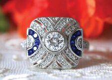 0.8 Ct Blue Sapphire Brilliant Moissanite Engagement Ring In 9K White Gold