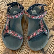 Teva women's brown, pink, and red sandals