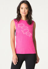 $49 NWT NEW BEBE SPORT PINK GLOW DROPPED ARMHOLE TANK TOP M.