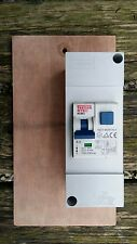For shed or garage lighting  2 Pole 6kA RCBO with cover on wooden  back board.
