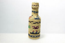 Circa 2000- Polychrome Grass Basketry Covered Bottle with Deer, Birds, Canoes