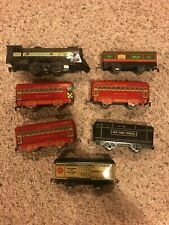 7 Antique Tin Metal Trains Engine Locomotive and other cars