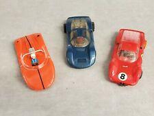 Three 1/32 scale slot cars