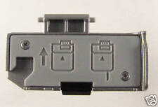 Canon EOS 1000D  Silver Battery Chamber Cover/Door NEW. CG2-2216-000
