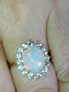 Natural solid white rainbow Fire Opal halo ring 9ct rose & yellow gold