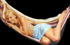 JOSIE BISSET - IN A SKIRT AND A TOP CUDDLED UP ON A HAMMOCK !!!