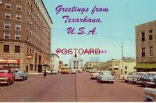 GREETINGS FROM TEXARKANA. STATELINE AVENUE - Texas on left, Arkansas on right