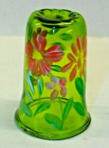 A  GREEN GLASS HAND PAINTED FLOWER THIMBLE WITH AN INDENT ON TOP 4