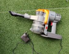 Dyson DC16 handheld vacuum cleaner, used with charger.