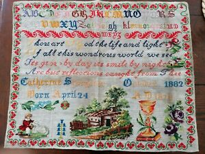 Antique Victorian sampler dated 1882 in lovely condition unframed .