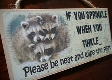 IF YOU SPRINKLE WHEN YOU TINKLE PLEASE BE NEAT AND WIPE THE SEAT Raccoon Sign