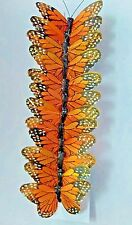 One dozen feather crafted monarch butterflies , crafts
