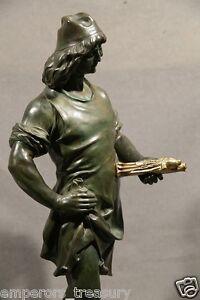 20th Century Florentine Bronze Figure Holding Gilded Statue of Virgin & Child