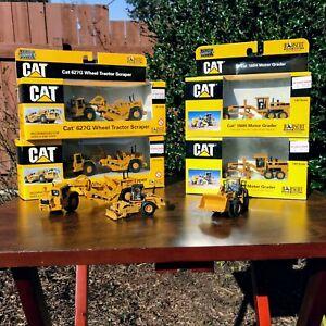 LOT of SEVEN 1:87 Norscot CAT Construction Grader, Scraper, Loader, Compactor