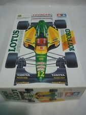 Tamiya un made plastic kit of a 1992 Lotus 107, ford V8, Parts sealed in bags