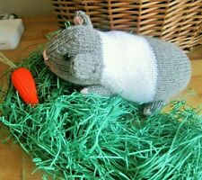 A HAND KNITTED  GREY AND WHITE GUINEA PIG AND CARROT. EASTER GIFT? LIFE SIZED.