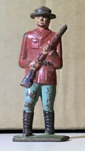 Vintage Cast Iron Toy Solider Canadian Mountie Mounted Police Figure Red Coat