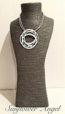 Abstract short necklace, frosted  circles pendant, 2 silver leather cords.