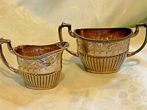 Vintage silver plated decorative creamer and sugar bowl set