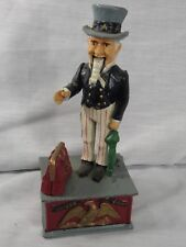 VINTAGE REPRODUCTION UNCLE SAM HEAVY CAST IRON MECHANICAL COIN BANK!