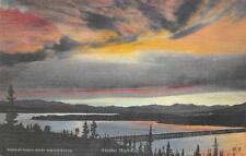 NISUTLIN BAY AT SUNSET BRIDGE ALASKA HIGHWAY POSTCARD (c. 1940s)