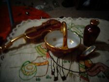 5 pieces red and gold limoges in excellent condition.beautiful pattern