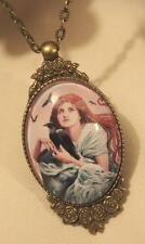 Lovely Floral Rim Brasstn Red Hair Goth Girl Holding a Raven Bird Cameo Necklace