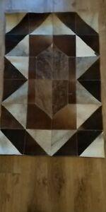 Cowhide Designer Patchwork rug. Ideal as bedside/wall rug. Rare hair-on skin