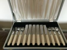 CASED SET OF 12 CHROME PLATED & IVORINE HANDLED FISH KNIVES & FORKS (CPFK&F 23)