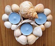 Hand made decorative tea light. Natural sea shell candle holder