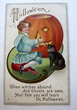 1920s  Halloween Postcard Girl Carving Pumpkin w/ Black Cat Watching
