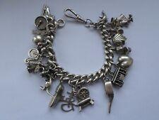 Sterling silver charm bracelet - 20 charms 89 grms Dumbo tram kangaroo windmill