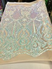 AQUA PRINCESS IRIDESCENT SEQUINS ON A 4 WAY STRETCH NUDE MESH-SOLD BY YARD.